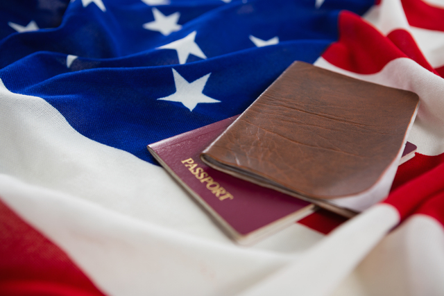 Close-up of passport and visa on an American flag